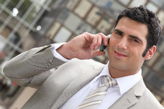Executive using a cellphone Stock Images