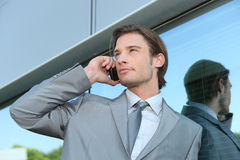 Executive using a cellphone Stock Photo