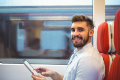 Executive using digital tablet travelling in train Royalty Free Stock Photos