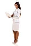 Executive using laptop Royalty Free Stock Image