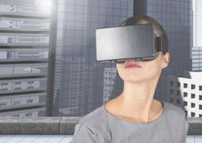 Executive using virtual reality headset against office building. Digital composite of executive using virtual reality headset against office building royalty free stock images