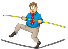 Executive walking a tightrope. Royalty Free Stock Image