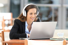 Executive watching video lecture on line in a bar Royalty Free Stock Photo