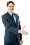 Executive welcoming you with a handshake Royalty Free Stock Images