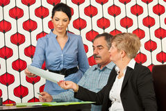Executive woman giving paper at meeting Stock Photos