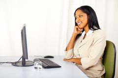 Executive woman looking the computer screen Royalty Free Stock Images