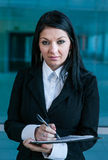 Executive woman making notes Royalty Free Stock Image