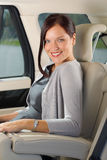 Executive woman manager sitting in car backseat Stock Photo