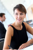 Executive woman in office Stock Image
