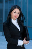 Executive woman poses with a folder Stock Image