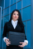 Executive woman poses with a folder Royalty Free Stock Images
