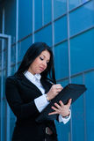 Executive woman poses with a folder Royalty Free Stock Photo