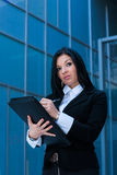 Executive woman poses with a folder Stock Images