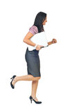 Executive woman running and holding laptop royalty free stock photo