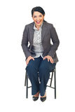Executive woman sit on chair and laughing out loud Royalty Free Stock Photography