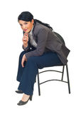 Executive woman sitting on chair Stock Photos