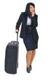 Executive woman with suitcase waiting Stock Images