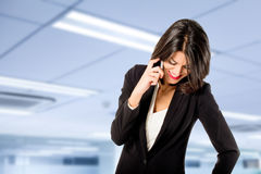 Executive woman talking on the phone Royalty Free Stock Image