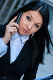 Executive woman talking on phone Stock Photos