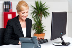 Executive woman working at the office. Business woman working on computer at her office Royalty Free Stock Photo