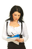 Executive woman writing on papers Stock Images