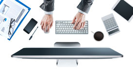 Executive working at desk Stock Photography