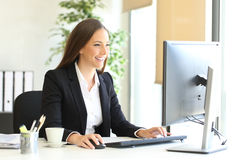 Executive working with a desktop computer Stock Images