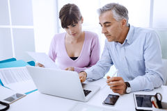 Executive working with his assistant Stock Images