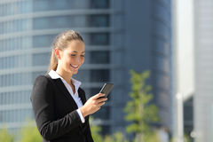 Executive working with a mobile phone Royalty Free Stock Images