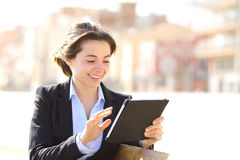 Executive working with a tablet in a park Royalty Free Stock Photo