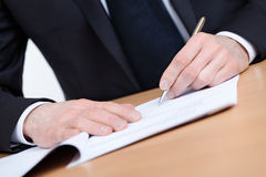 Executive writing in the notebook Stock Image