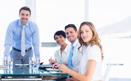Executives around conference table in office royalty free stock image