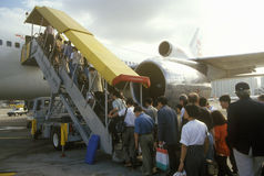 Executives boarding a passenger jet in Hong Kong Stock Photo