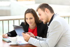 Executives consulting on line content in a coffee shop royalty free stock photo