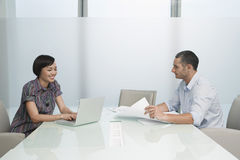 Executives With Documents And Laptop In Conference Room Royalty Free Stock Photography