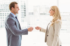 Executives exchanging business card in office stock image