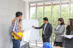 Executives are explaining plans on a whiteboard. Confident boss royalty free stock photography