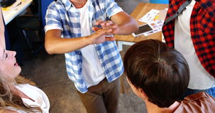 Executives giving high five and forming huddle in office. Smiling executives giving high five and forming huddle in office