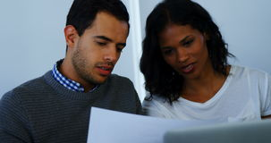 Executives having discussion over document. In office stock footage