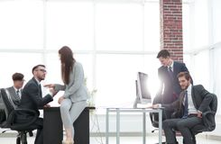 Business people discussing over new business project in office. Executives having friendly discussion during break stock image