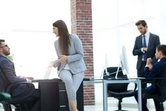 Business people discussing over new business project in office. Executives having friendly discussion during break stock images