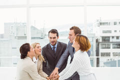 Executives holding hands together in office Royalty Free Stock Photography