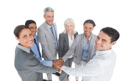 Executives holding hands together in office. Portrait of happy executives holding hands together in the office royalty free stock photo