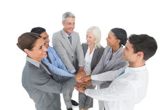 Executives holding hands together in office Stock Photos