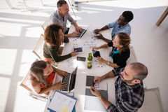 Executives interacting with each other during meeting. In office royalty free stock photo