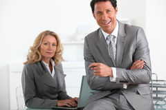 Executives with laptop computer Royalty Free Stock Photo