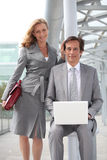 Executives with laptop computer. Pair of confident executives with laptop computer stock images