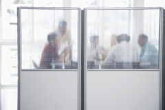 Executives In Meeting Behind Translucent Wall Royalty Free Stock Images