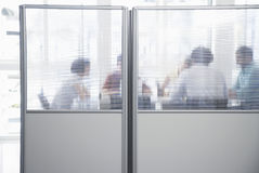 Executives In Meeting Behind Translucent Wall Royalty Free Stock Photography