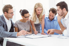 Executives in meeting at office. Young business people in meeting at office royalty free stock photo